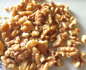when crumble top is brown and bubbly, sprinkle with crashed walnuts, let cook for another few minutes until walnuts start to be lightly toasted