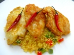 top couscous with chicken cutlets and chilis, drizzle with good quality olive oil and a few spritz of fresh lime