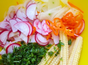 Make a salad of lettuce, baby corn, chilies, radish, onion, cilantro, salt, garlic paste, olive oil and lemon juice
