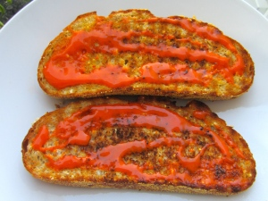 spread both slices of bread on one side with Hans'Homemade Buffalo Sauce