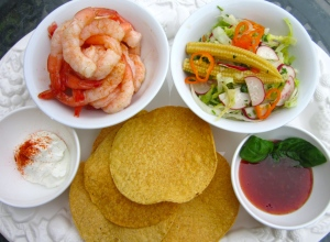 serve shrimp and salad  with fried tortillas (totopos), sour cream Thai chili sauce