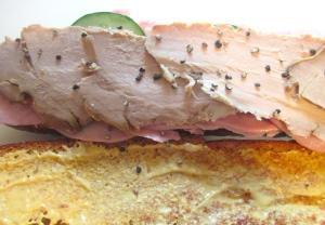 add sliced roast pork (schweinebraten), sprinkle with freshly ground black pepper