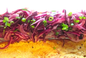 top with red cabbage salad (rotkraut salat)