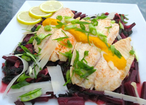 Sauteed Red Beet Leaves With Steamed Swai Filet, Aji Amarillo Sauce, Parmesan Shavings & Scallions
