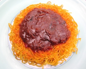 top noodles with generous amount of  onion/sauce