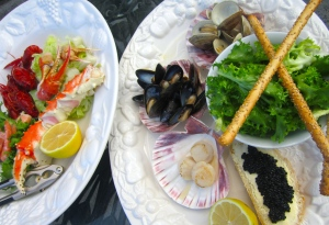 Seafood Salad - lettuce in lime vinaigrette, endive in lime vinaigrette, grissini, lemon, caviar on sour dough bread, mussels, clams, shrimp. king crab, snow crab, crayfish, scallops