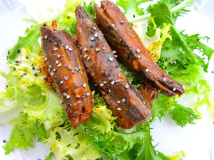 top frisee with sardines in tomato sauce, (PLEASE  use a top notch product), sprinkle with freshly ground black pepper