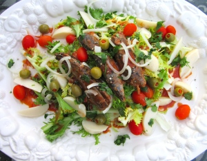 top with potatoes, grape tomatoes, onions and olives, sprinkle with fresh chervil or italian parsley