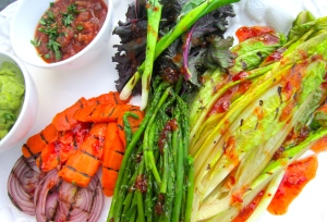 drizzle all veggies generously with thai chili sauce, add guacamole and salsa mexicana for dipping