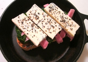 top ham with thick slices of gorgonzola, sprinkle with fresh cracked black pepper