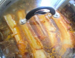 simmer covered until pork is tender but NOT falling apart, remove pork, set aside, reduce sauce until thickened and onions are very soft, check / adjust seasoning
