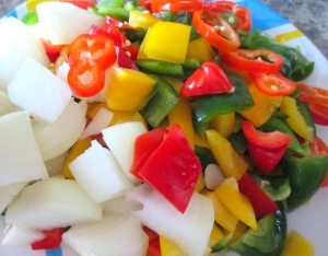 add diced onions, sliced chilies and peppers