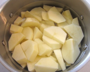 peel and slice potatoes, simmer in salted water until soft