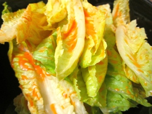 dress romaine leaves with a dressing of finely chopped sundried tomatoes, lime juice, olive oil, kosher salt and cayenne pepper