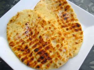 meanwhile, cook naan, brush with ghee, sprinkle with kosher salt