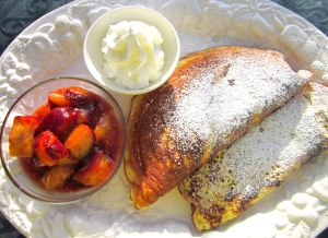 to serve, sprinkle pancakes with castor sugar, serve with caramelized plums and unsweetened whipped cream