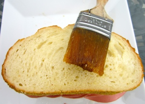 put both breads together, brush both slices with garlic oil