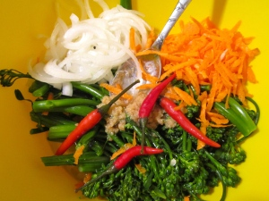 blanched broccolini, garlic paste, pickled chilies, sliced onions, shredded carrots