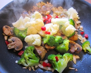 add diced peppers, blanched broccoli and blanched cauliflower
