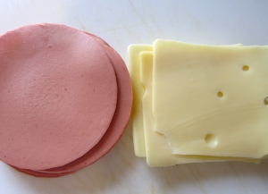 slice bologna and swiss cheese into julienne(or other protein / cheese of your choice)