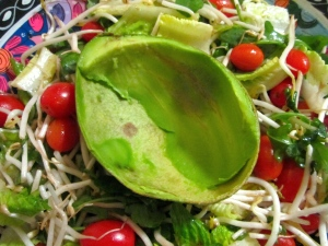 place avocado shell on salad nest