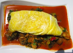 place egg atop of veggie-curry, add a small dollop of greek yogurt and more chopped cilantro