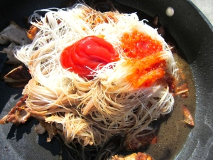 add rice sticks, equal parts of hoi sin sauce, chicken stock, oyster sauce, soy sauce, sweet thai chili sayce and ketchup )don't scoff on the ketchup, it adds acidity and sweetness as well as richness to the dish