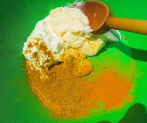 mix greek yogurt, mayo, mustard, curry powder, turmeric powder, rice vinegar, kosher salt and cayenne pepper