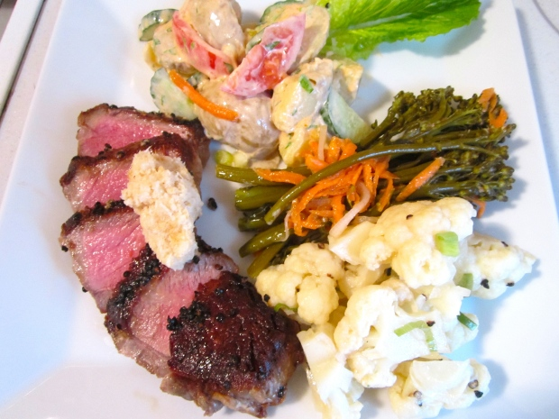 new york strip with pickled broccolini, pickled cauliflower and potato salad