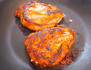 turn chicken, turn down temperature a bit, cook until cooked through