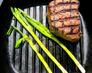 add a few scallions (seasoned with salt, garlic oil and chili oil) during the last few minutes of cooking the steak