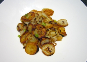 plate potatoes, sprinkle with sliced chives