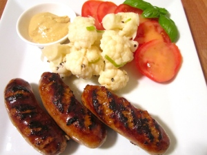 spicy italian sausages with pickled cauliflower and tomato in honey/mustard vinaigrette