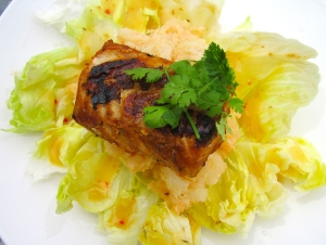 top lettuce with potatoes, top potatoes with cod filet