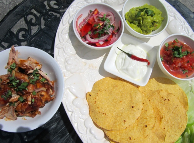 flour tostadas, chicken in chipotle, salsa mexicana, tomato/onion salad, sour cream, guacamole, pickled chili