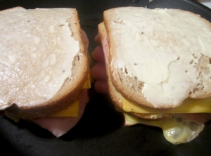 top with another mayonnaise-covered, one side griddled bread, griddle side down