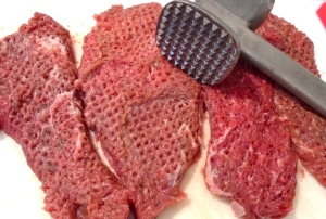 """pound your choice of beef steak to 1/4"""" thick, season with salt and cayenne pepper"""