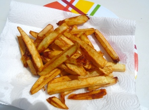 remove fries to absorbent paper, sprinkle with kosher salt
