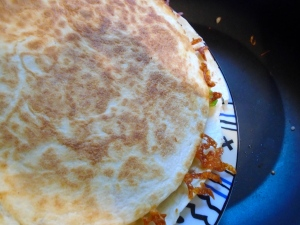 top tortilla with a plate, invert,