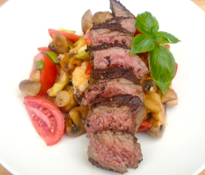 arrange sliced steak on top of veggies and puree