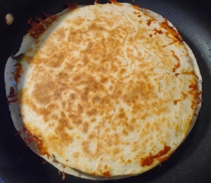 slide back into pan (or comal), cook very slowly to give the cheese time to melt without burning the tortilla