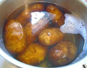 simmer potatoes in saltwater until tender but still firm, drain