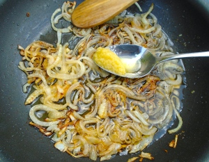 meanwhile, saute finely sliced onions with garlic paste in olive oil until onions are caramelized, reserve