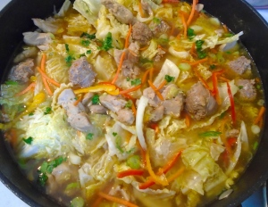 add sliced napa cabbage, finely sliced peppers and chopped cilantro, check / adjust seasoning