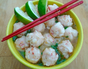 add lobster balls and soup, serve with lime wedges
