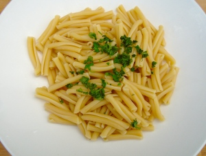plate freshly cooked casarecce pasta to soup plate, sprinkle with chopped cilantro