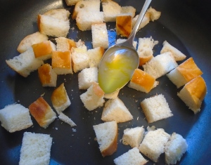 saute croutons in garlic oil, season with kosher salt and cayenne pepper