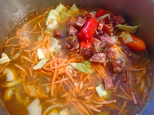 add chillies, carrot julienne, white cabbage and chorizo, simmer for three more minutes