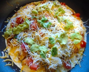 top with more cheese and mashed avocado