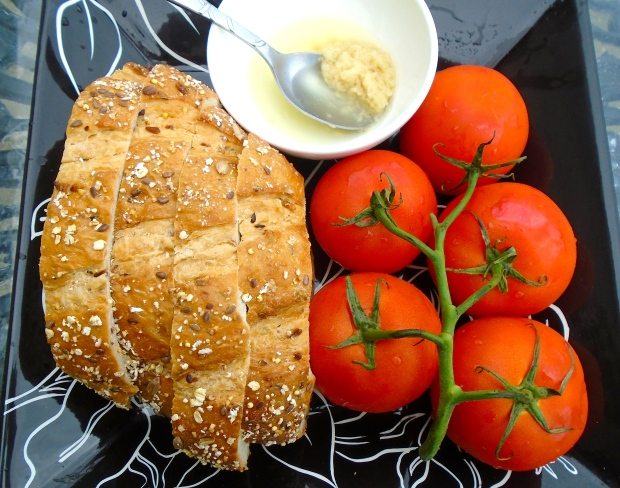 sour dough bread, vine-ripened tomatoes, garlic-confit paste in olive oil